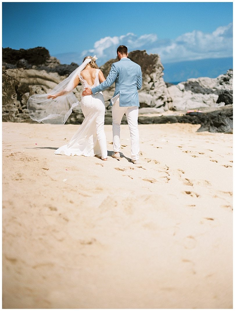 ironwoods-beach-elopement-maui-bride-groom-walking-romantic