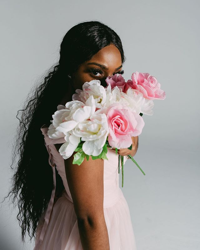 A flower does not think of competing with the flower next to it. It just blooms. . . . . . . #flowers #bloom #femalerapper #hiphop #pink #dress #chh #omgitswande #wclub #wmag