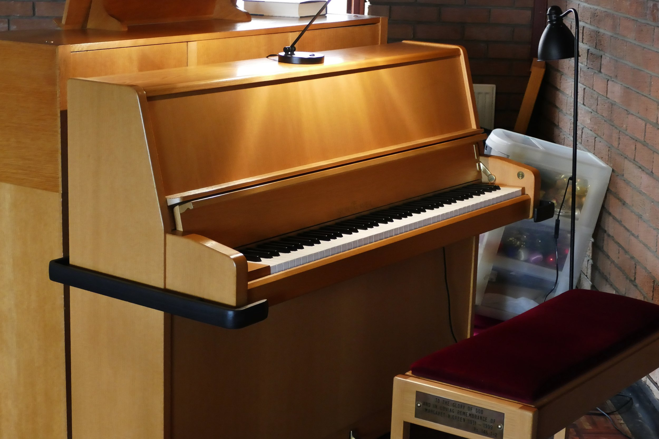 This is the beautiful Schimmel piano which stands back to back with the Organ Console. Its used for services,  and social events such as the Romiley music group. The piano has a built in studio trolley and can easily be moved to any part of the church. As with the Organ console its kept locked when not in use.