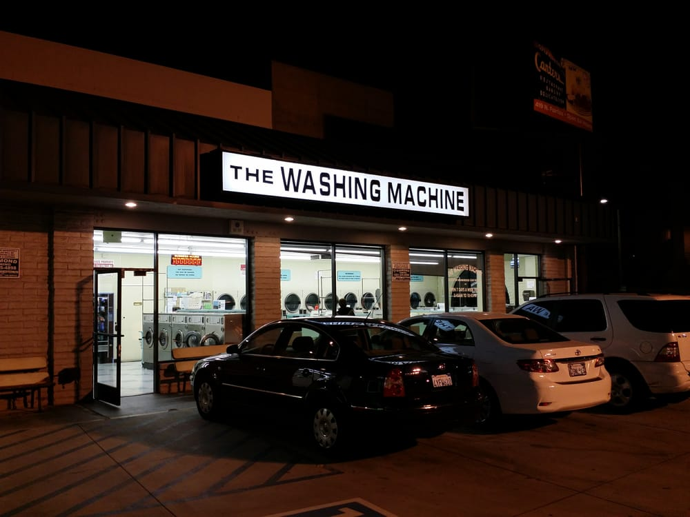 Another exterior shot of the laundromat at night