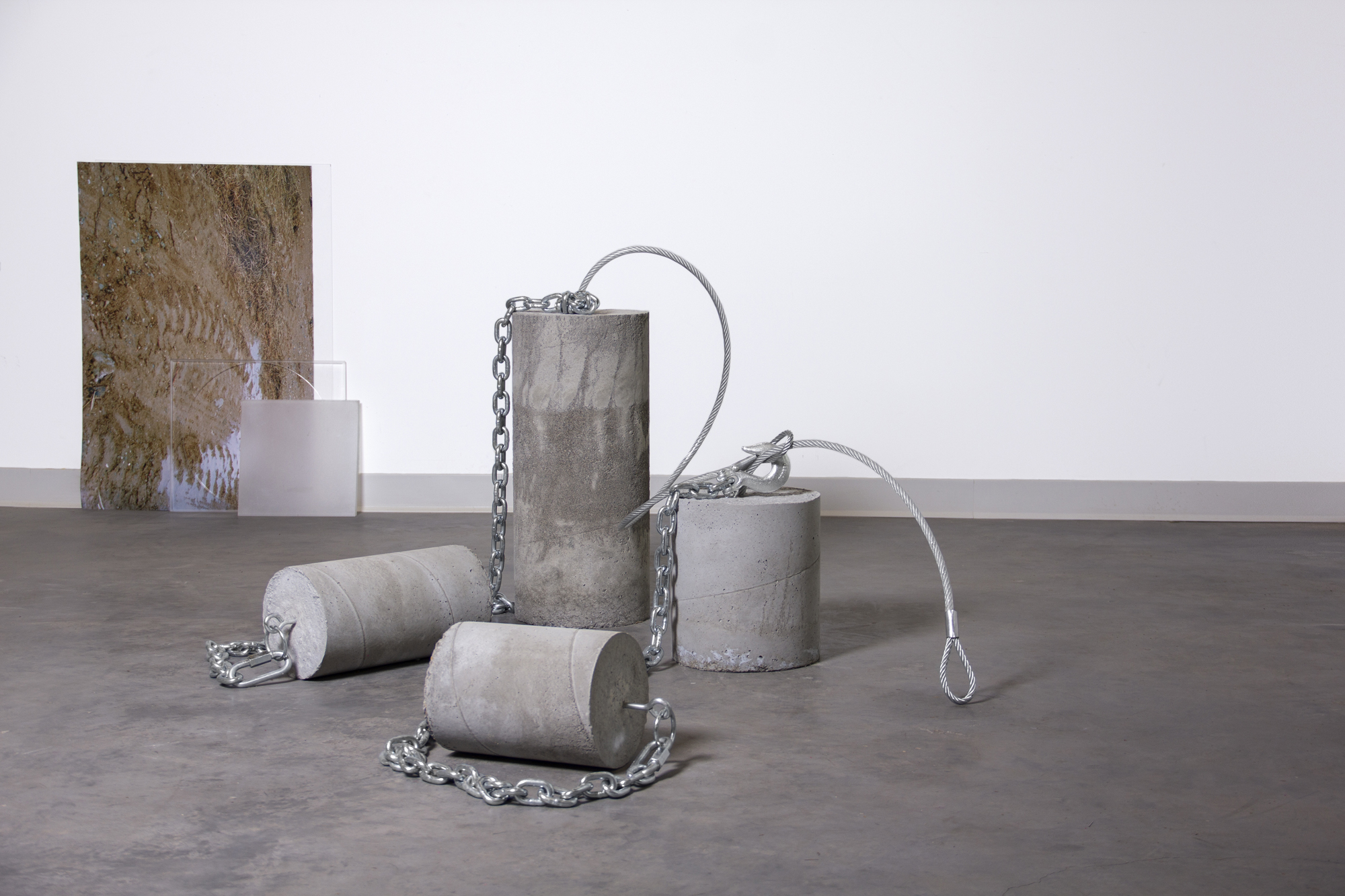 Performance I: Chained Cement, Dirt and Acrylic, 2019