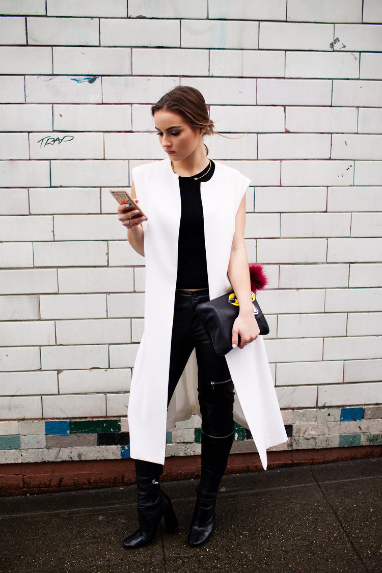 """""""Back in one of my favorite local designers,Valentina & Valentia, wearing their long white vest."""""""