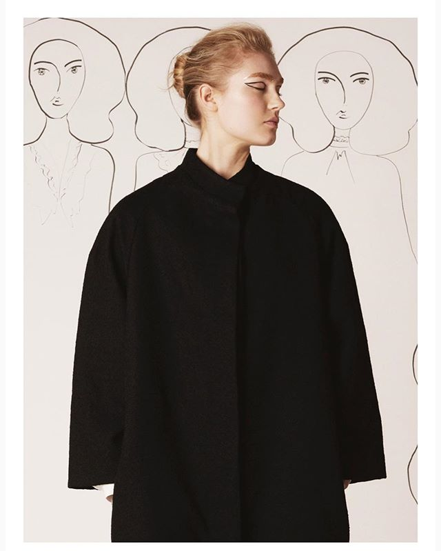 Elegant silhouette, luxurious black wool boucle and our signature pure silk lining in pale blue. Essentials.  Shop 'Vêndome' coat on valentinavalentia.com  #ValentinaandValentia #elegance #minimalism #essentials #luxury #puresilk #modern #minimalism #leaders