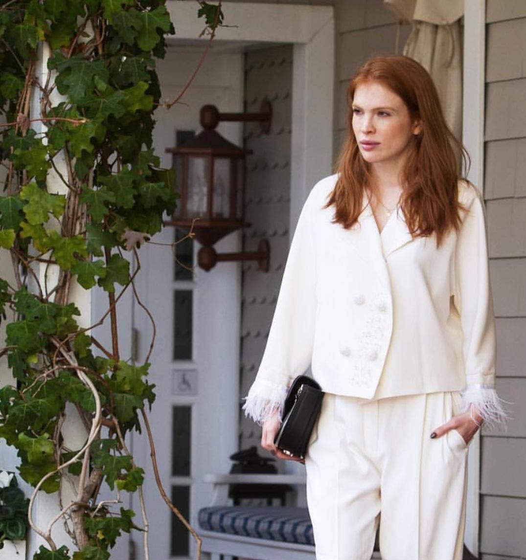 In all-white look in Santa Monica, California.
