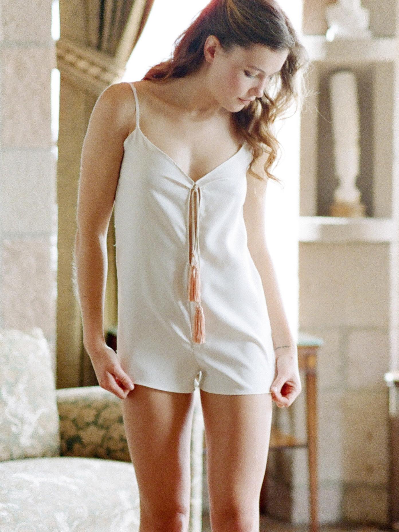 Ivory silk twill romper with blush tassels
