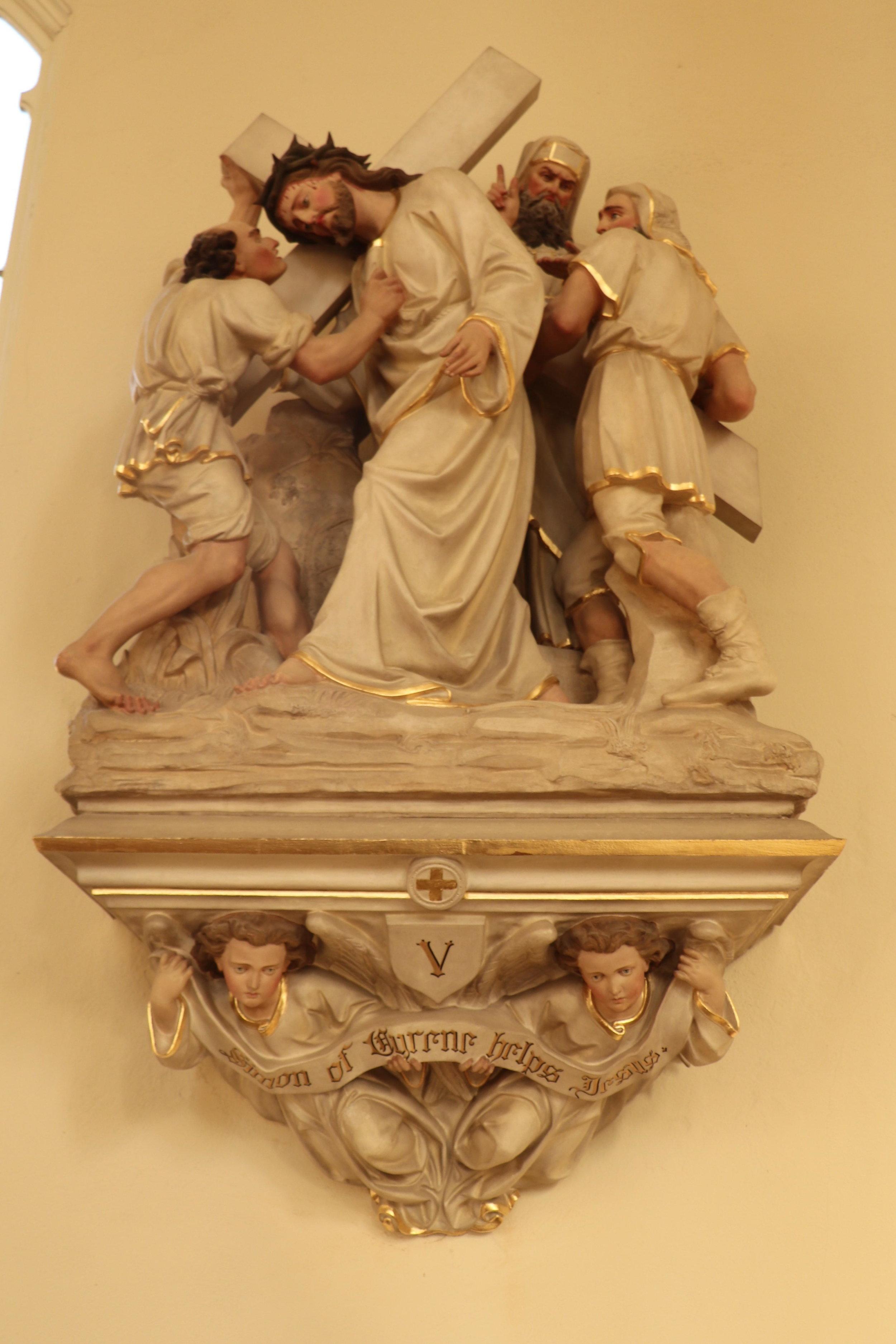 Simon helps Jesus with his Cross
