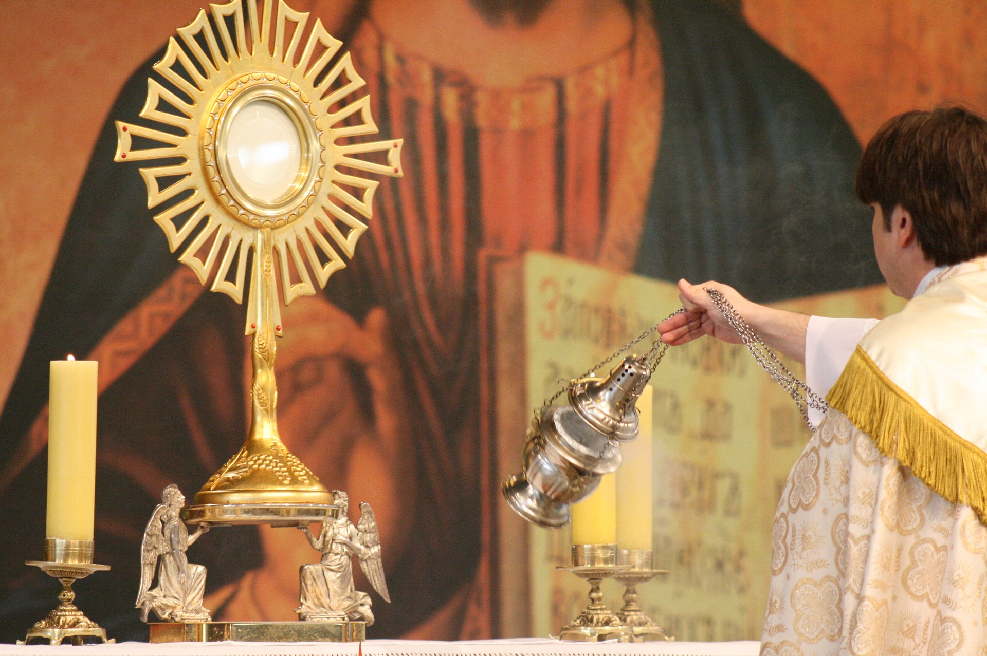 Priest swinging thurible during Adoration