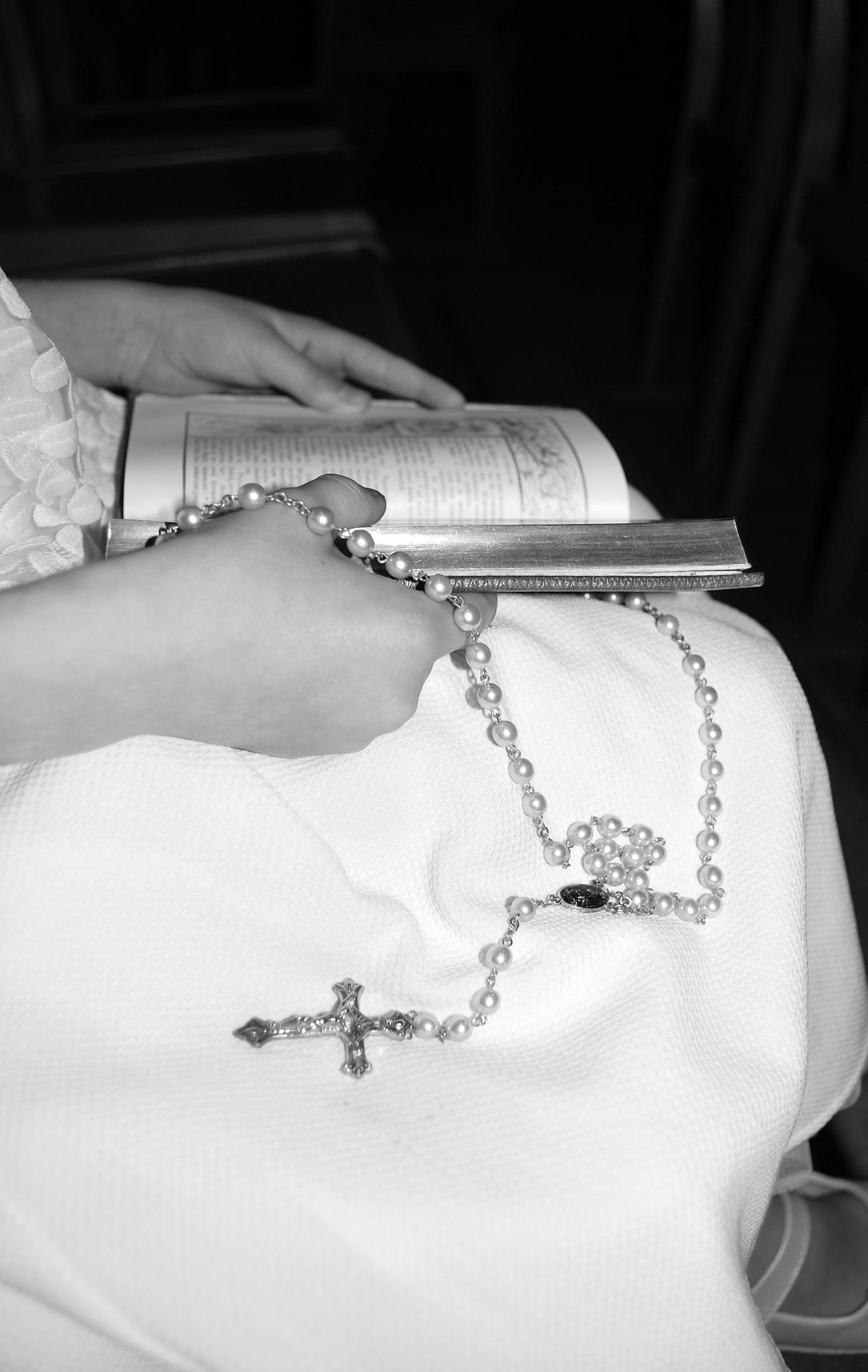 girl-holding-rosary-beads.jpg