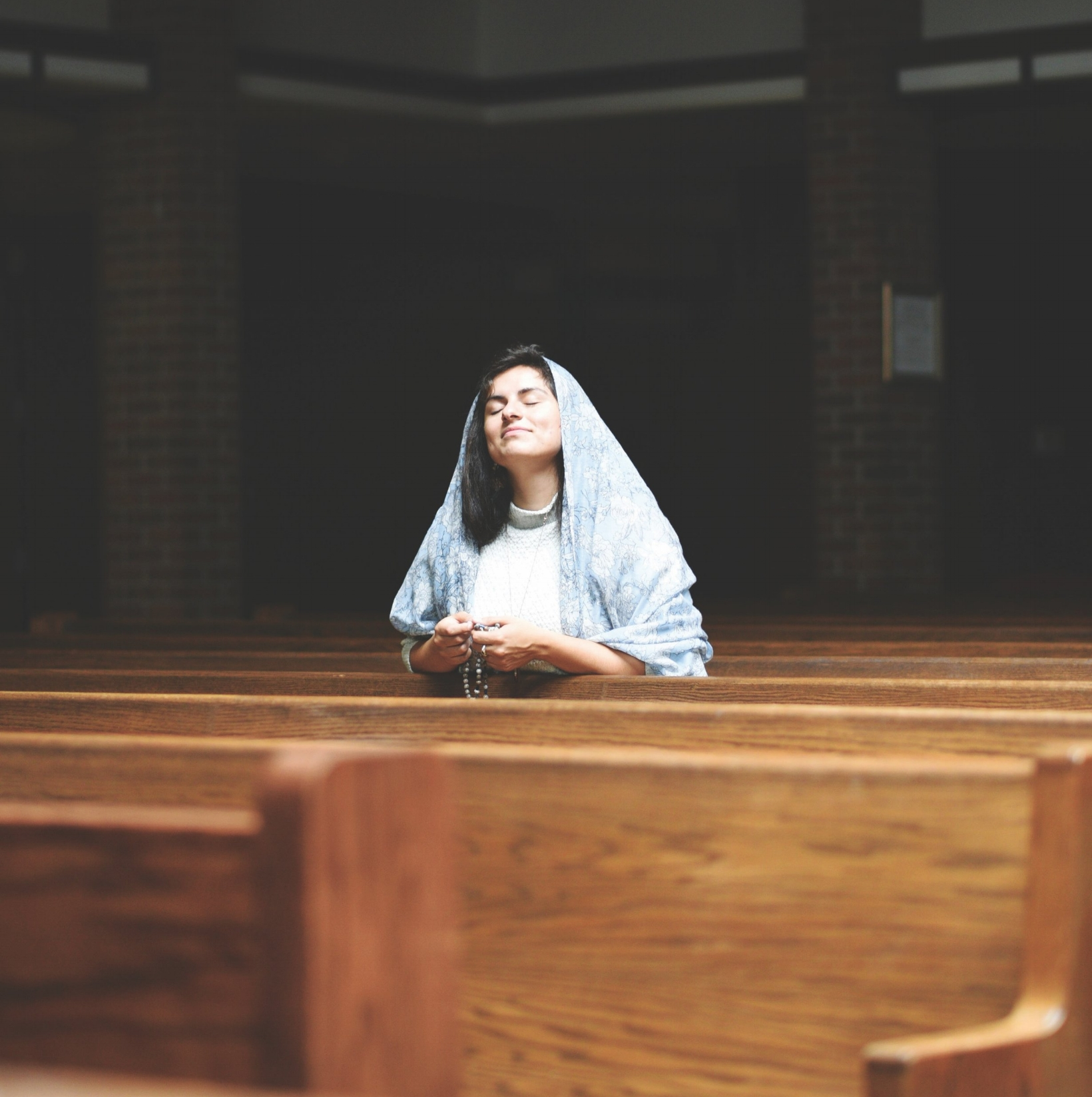 woman-praying-rosary-during-adoration.jpg
