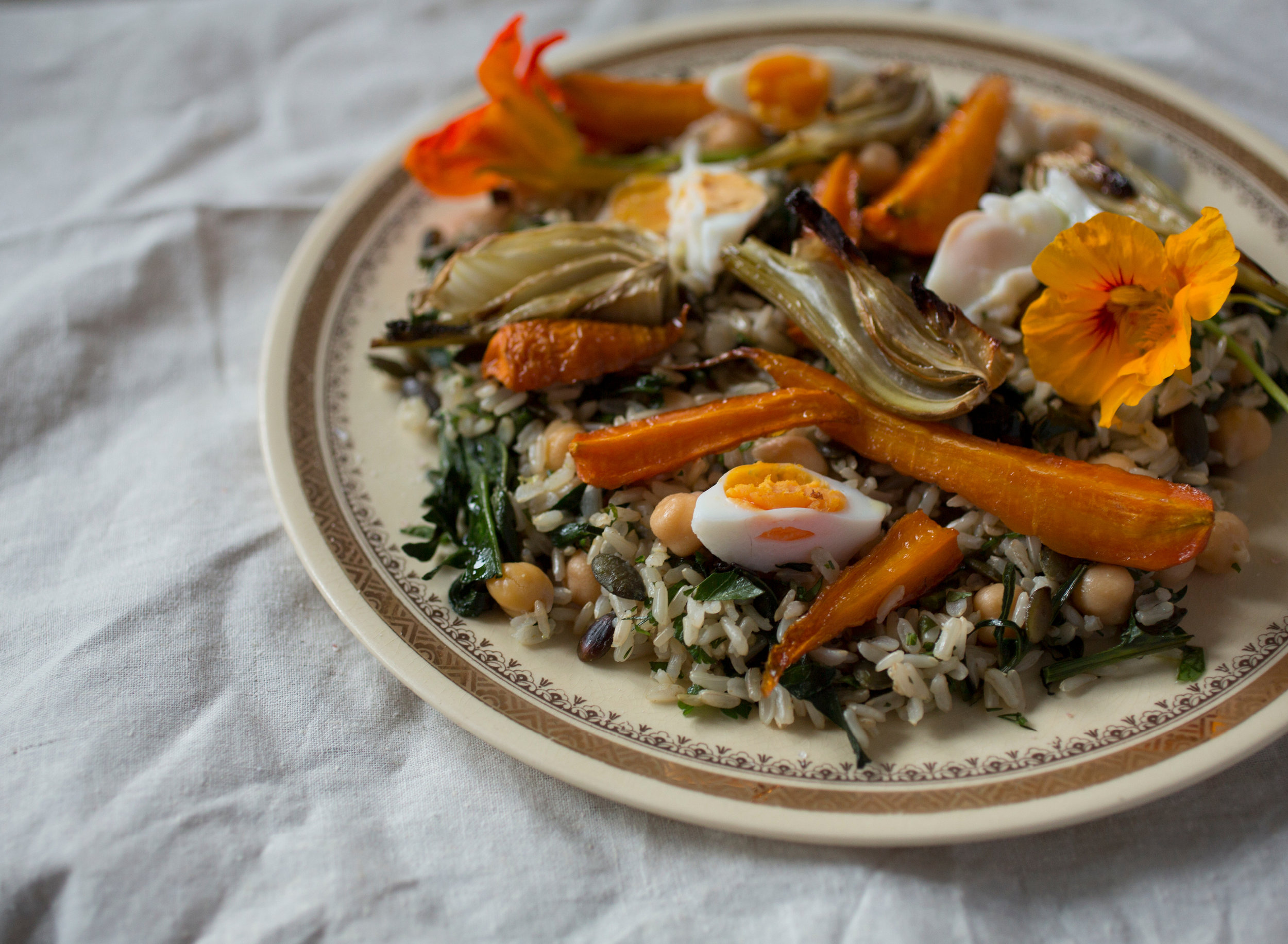 Variation 1 - roasted carrots and fennel topped with poached eggs and nasturtiums.