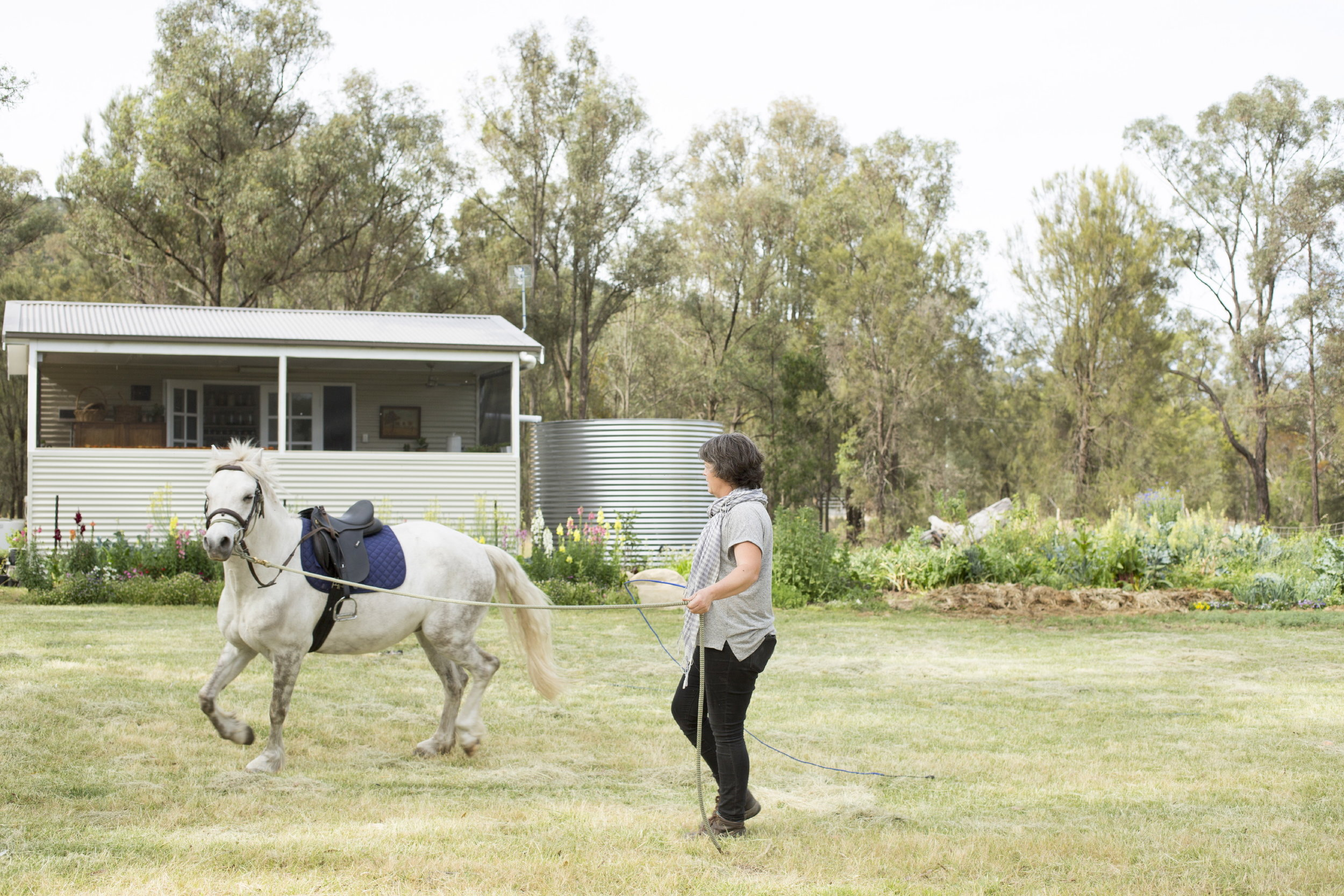 Tricia prepares for the school run outside of her tiny container home in the Hunter Valley.