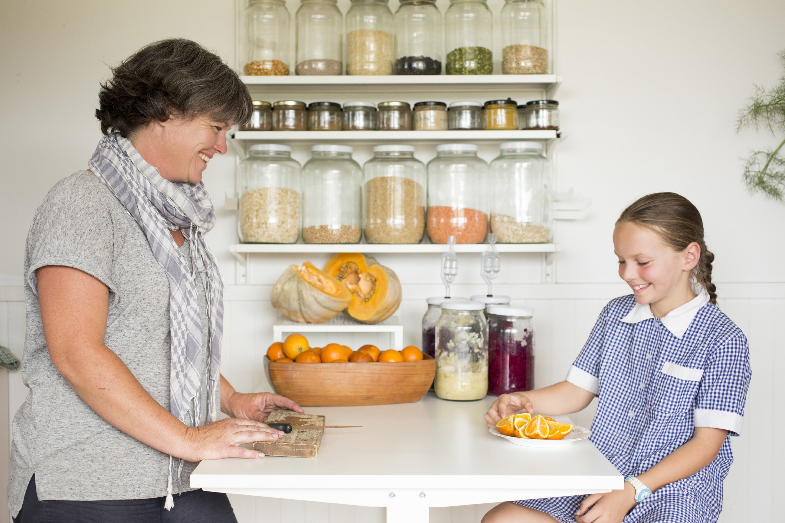Tricia and nine year old Olivia enjoy an afternoon snack in the kitchen of their tiny home.