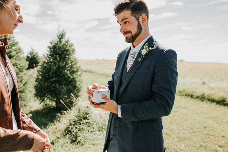 Cassidy & Isaac - Married - Nathaniel Jensen Photography - Omaha Nebraska Wedding Photograper - Nordstroms Christmas Tree Farm-20.jpg
