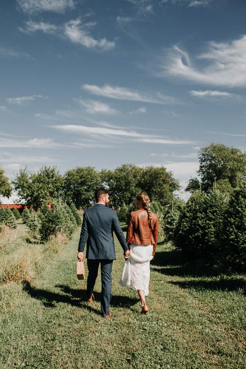 Cassidy & Isaac - Married - Nathaniel Jensen Photography - Omaha Nebraska Wedding Photograper - Nordstroms Christmas Tree Farm-25.jpg