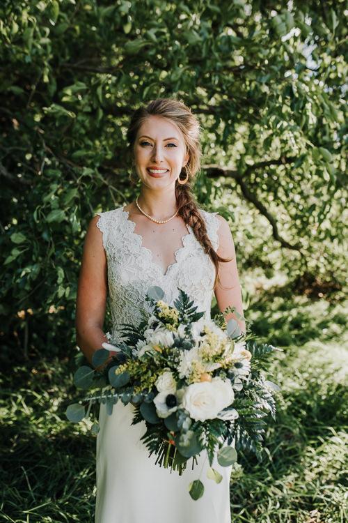 Cassidy & Isaac - Married - Nathaniel Jensen Photography - Omaha Nebraska Wedding Photograper - Nordstroms Christmas Tree Farm-68.jpg