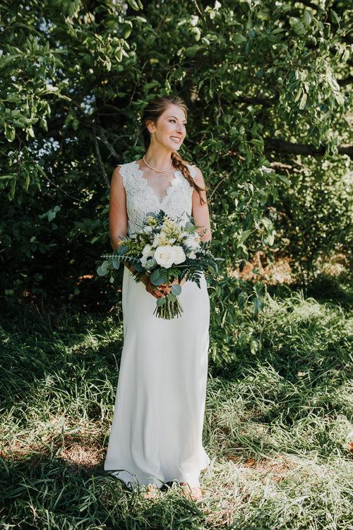 Cassidy & Isaac - Married - Nathaniel Jensen Photography - Omaha Nebraska Wedding Photograper - Nordstroms Christmas Tree Farm-74.jpg