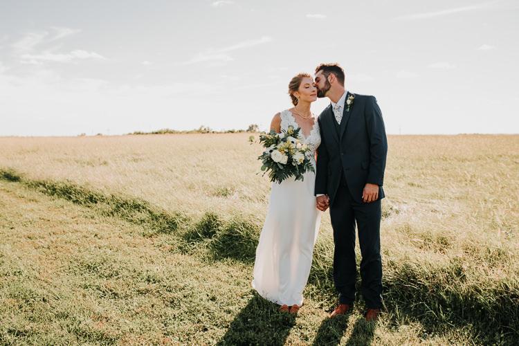 Cassidy & Isaac - Married - Nathaniel Jensen Photography - Omaha Nebraska Wedding Photograper - Nordstroms Christmas Tree Farm-146.jpg