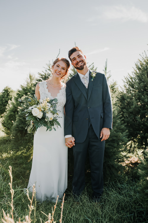 Cassidy & Isaac - Married - Nathaniel Jensen Photography - Omaha Nebraska Wedding Photograper - Nordstroms Christmas Tree Farm-147.jpg