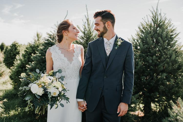 Cassidy & Isaac - Married - Nathaniel Jensen Photography - Omaha Nebraska Wedding Photograper - Nordstroms Christmas Tree Farm-148.jpg