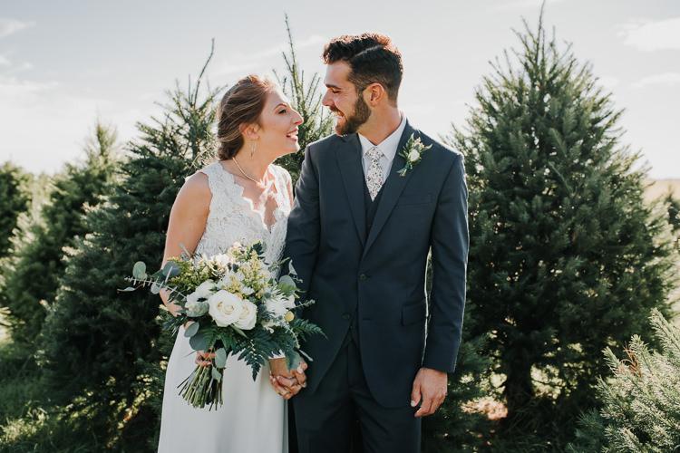 Cassidy & Isaac - Married - Nathaniel Jensen Photography - Omaha Nebraska Wedding Photograper - Nordstroms Christmas Tree Farm-149.jpg
