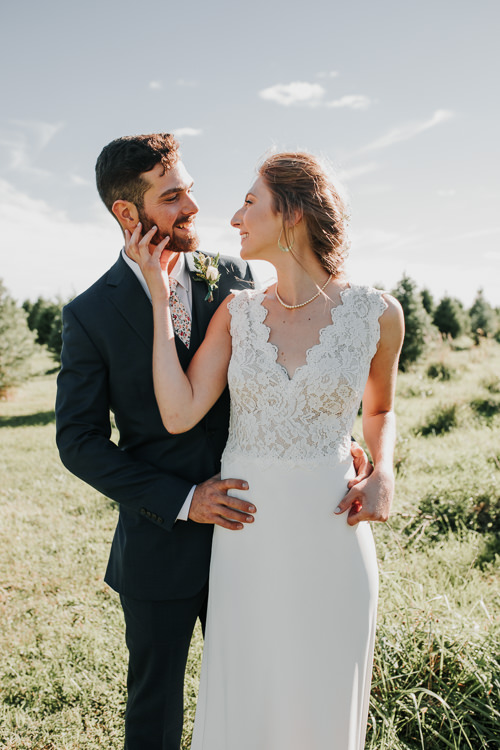 Cassidy & Isaac - Married - Nathaniel Jensen Photography - Omaha Nebraska Wedding Photograper - Nordstroms Christmas Tree Farm-152.jpg