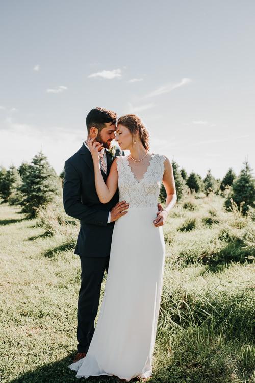 Cassidy & Isaac - Married - Nathaniel Jensen Photography - Omaha Nebraska Wedding Photograper - Nordstroms Christmas Tree Farm-156.jpg
