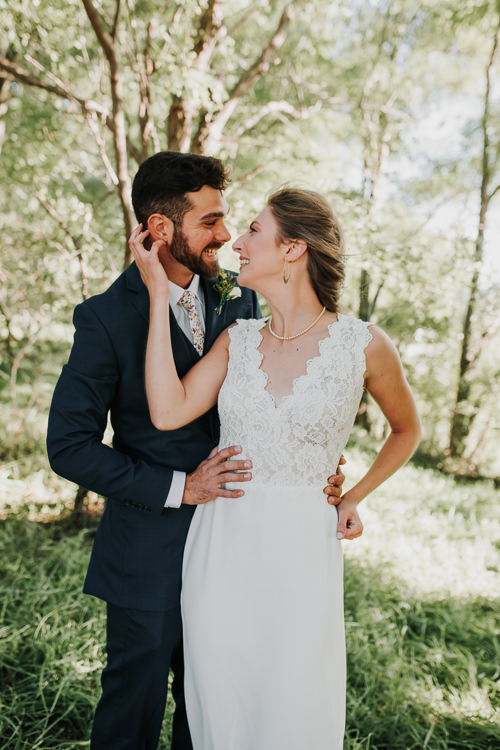 Cassidy & Isaac - Married - Nathaniel Jensen Photography - Omaha Nebraska Wedding Photograper - Nordstroms Christmas Tree Farm-163.jpg