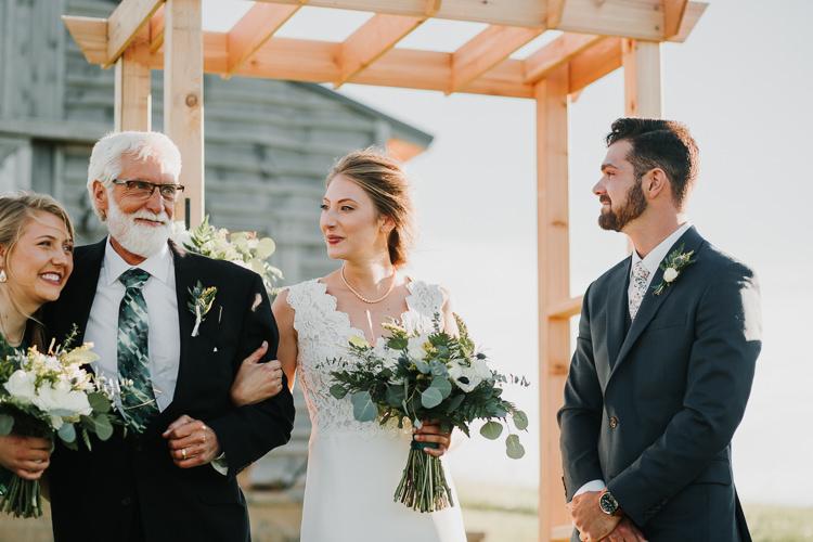 Cassidy & Isaac - Married - Nathaniel Jensen Photography - Omaha Nebraska Wedding Photograper - Nordstroms Christmas Tree Farm-277.jpg