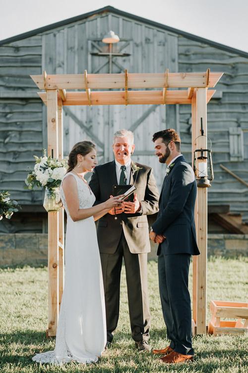 Cassidy & Isaac - Married - Nathaniel Jensen Photography - Omaha Nebraska Wedding Photograper - Nordstroms Christmas Tree Farm-293.jpg