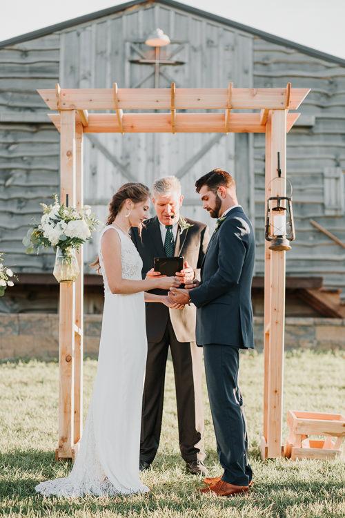 Cassidy & Isaac - Married - Nathaniel Jensen Photography - Omaha Nebraska Wedding Photograper - Nordstroms Christmas Tree Farm-295.jpg
