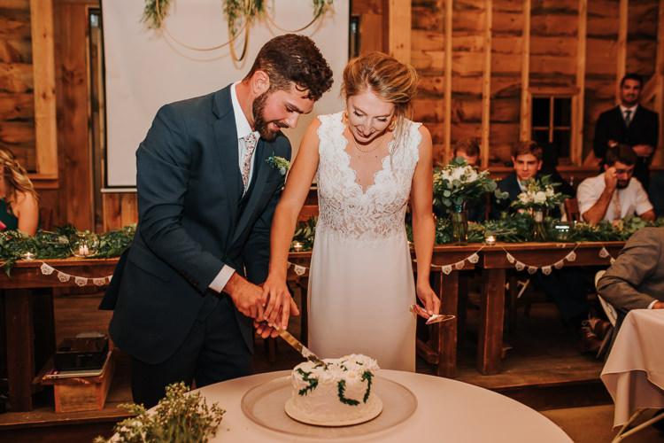 Cassidy & Isaac - Married - Nathaniel Jensen Photography - Omaha Nebraska Wedding Photograper - Nordstroms Christmas Tree Farm-418.jpg