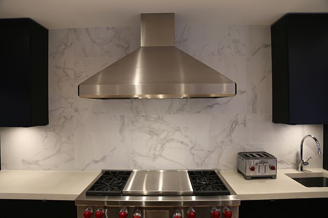 """It isn't too often that you can use 24"""" by 24"""" tiles on a backsplash; however, we did here and it turned out amazing! Tile supplied and installed by Prairie Concepts. #tile #backsplash #ames #lft #winnipeglocal"""