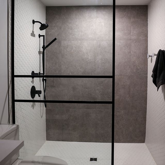 Custom Tile shower with heated bathroom floors. Supplied & Installed by Prairie Concepts. #prairieconcepts #tile  #exchangedistrictwinnipeg
