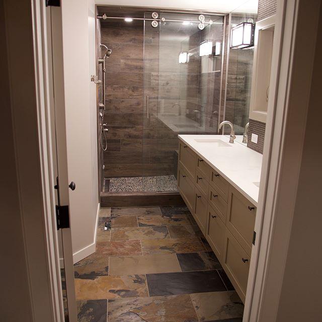 Custom tile shower with heated bathroom floors. Supplied & installed by Prairie Concepts. #prairieconcepts #hiddenbed #hiddenbedcanada #tile #exchangedistrictwinnipeg