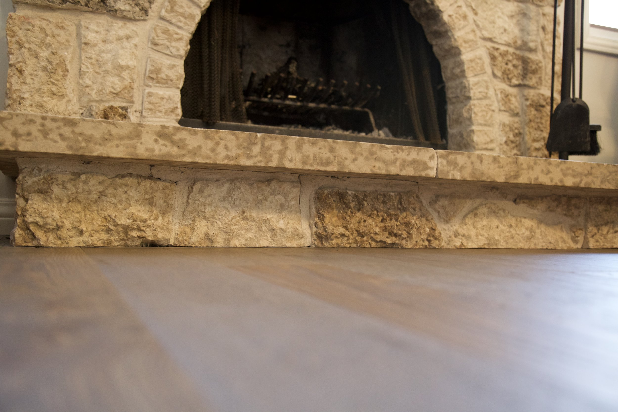 Custom Harwood install. Undercut existing brick for smooth seamles look.