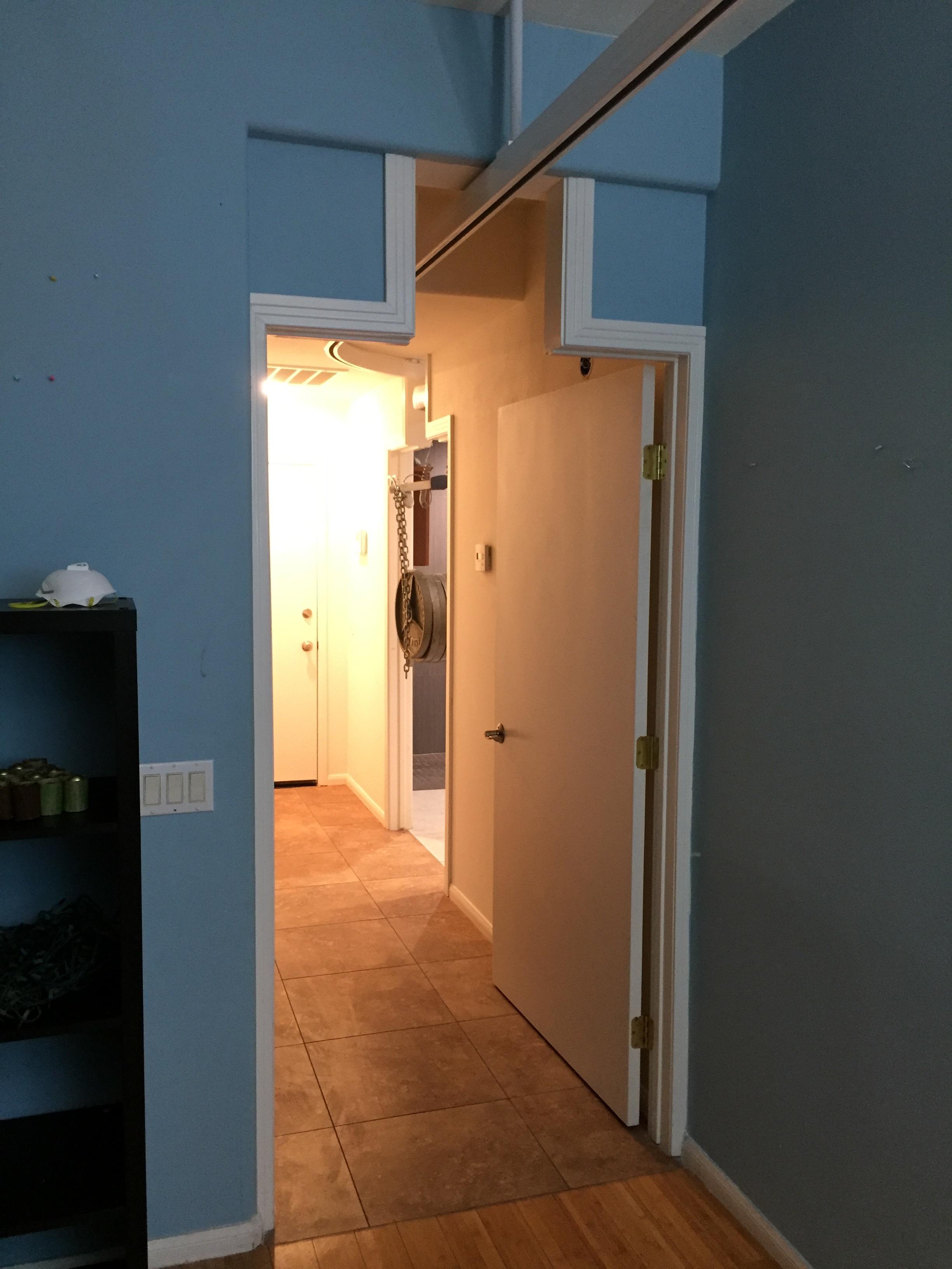 Patient lift track through door
