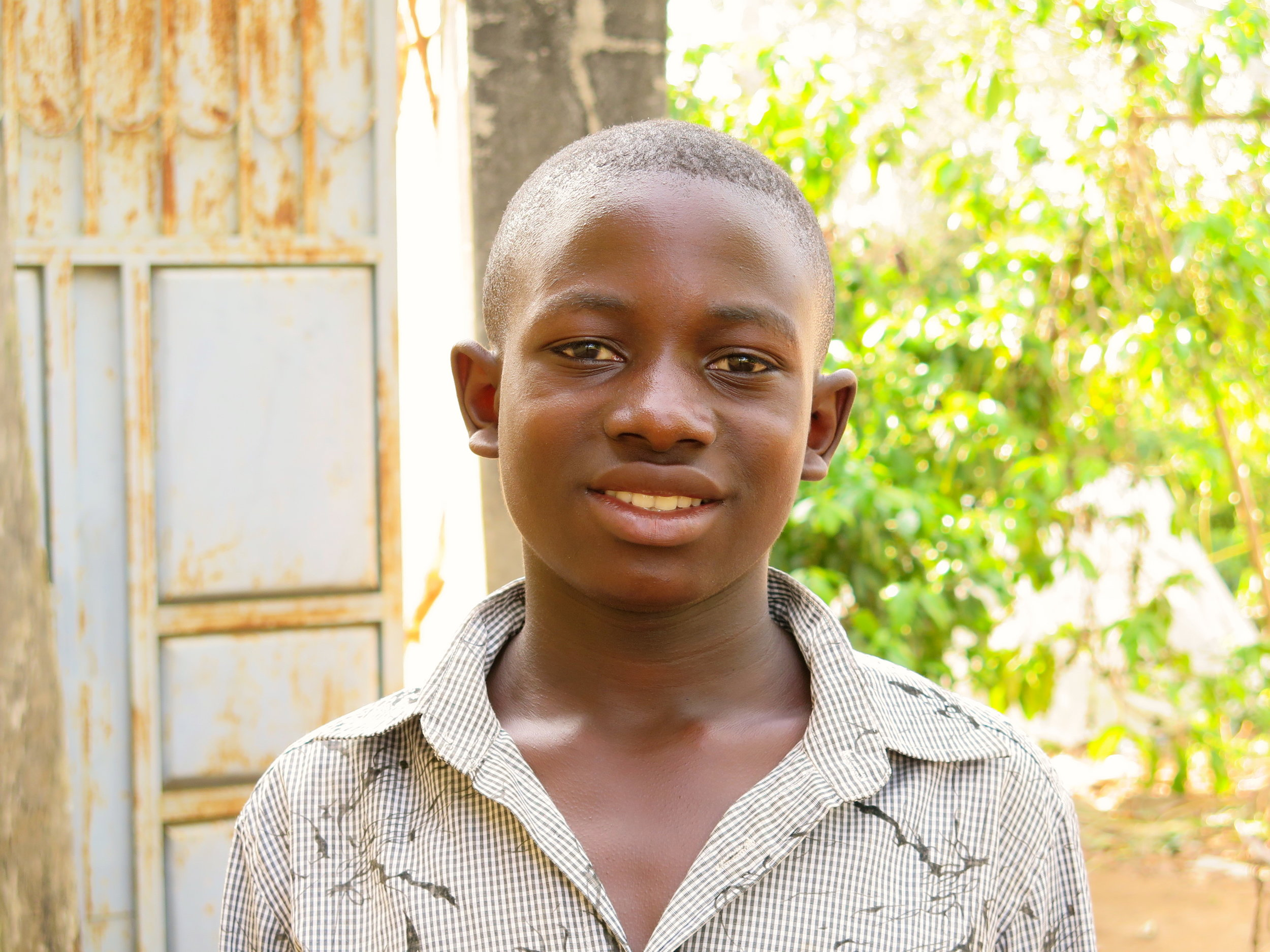 Emma  - in Senior One at Zaake Secondary School. He loves social studies and hopes to become a lawyer.