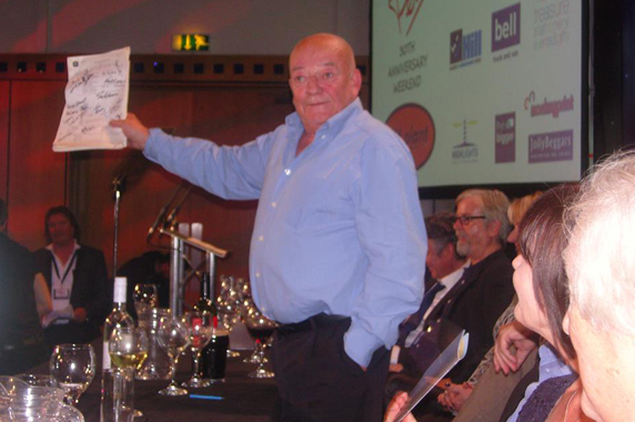 Tim shows off an original  Likely Lads  script during the auction.