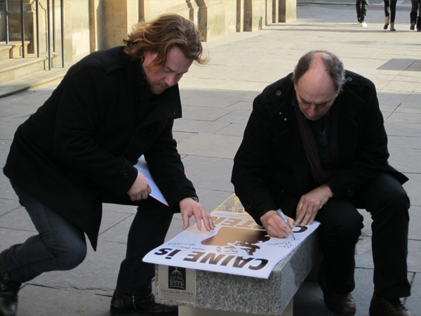 Alun signs  Get Carter  posters which were auctioned for fundraising.