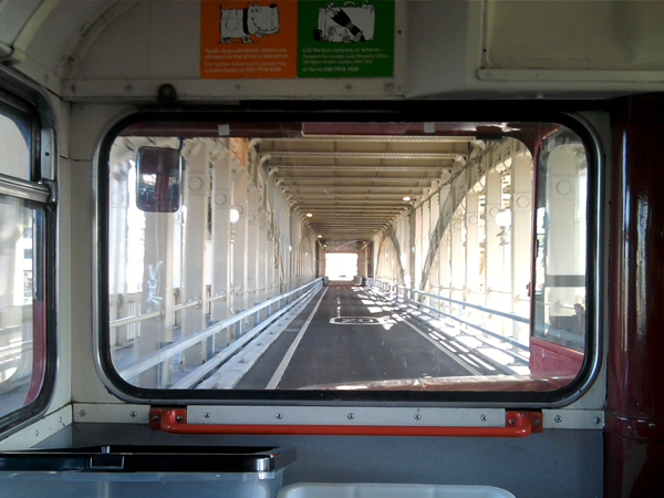 A view you don't see too often... the iconic High Level Bridge from the front seat of a London bus.
