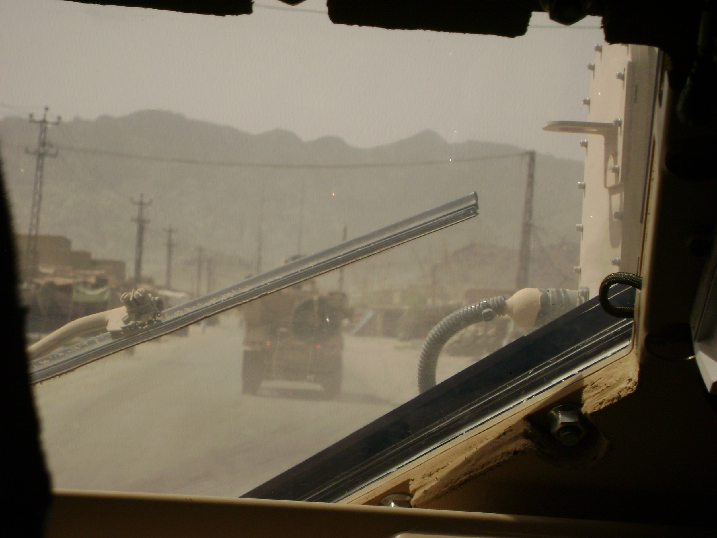 Afghanistan through the windshield of an armored vehicle, 2010.
