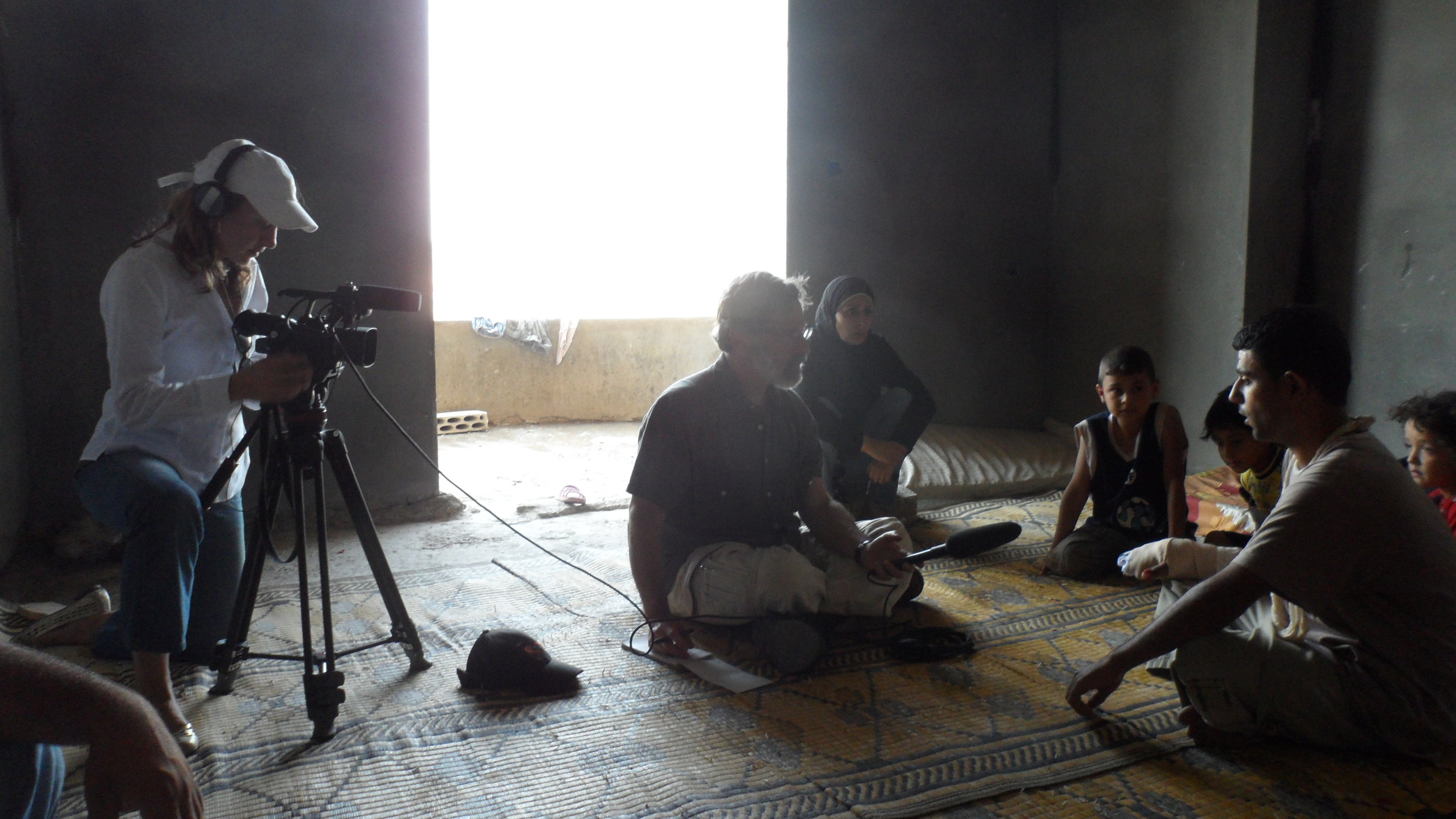 Interviewing a wounded Syrian rebel, with videographer Paige Kollack, Northern Lebanon, 2012.