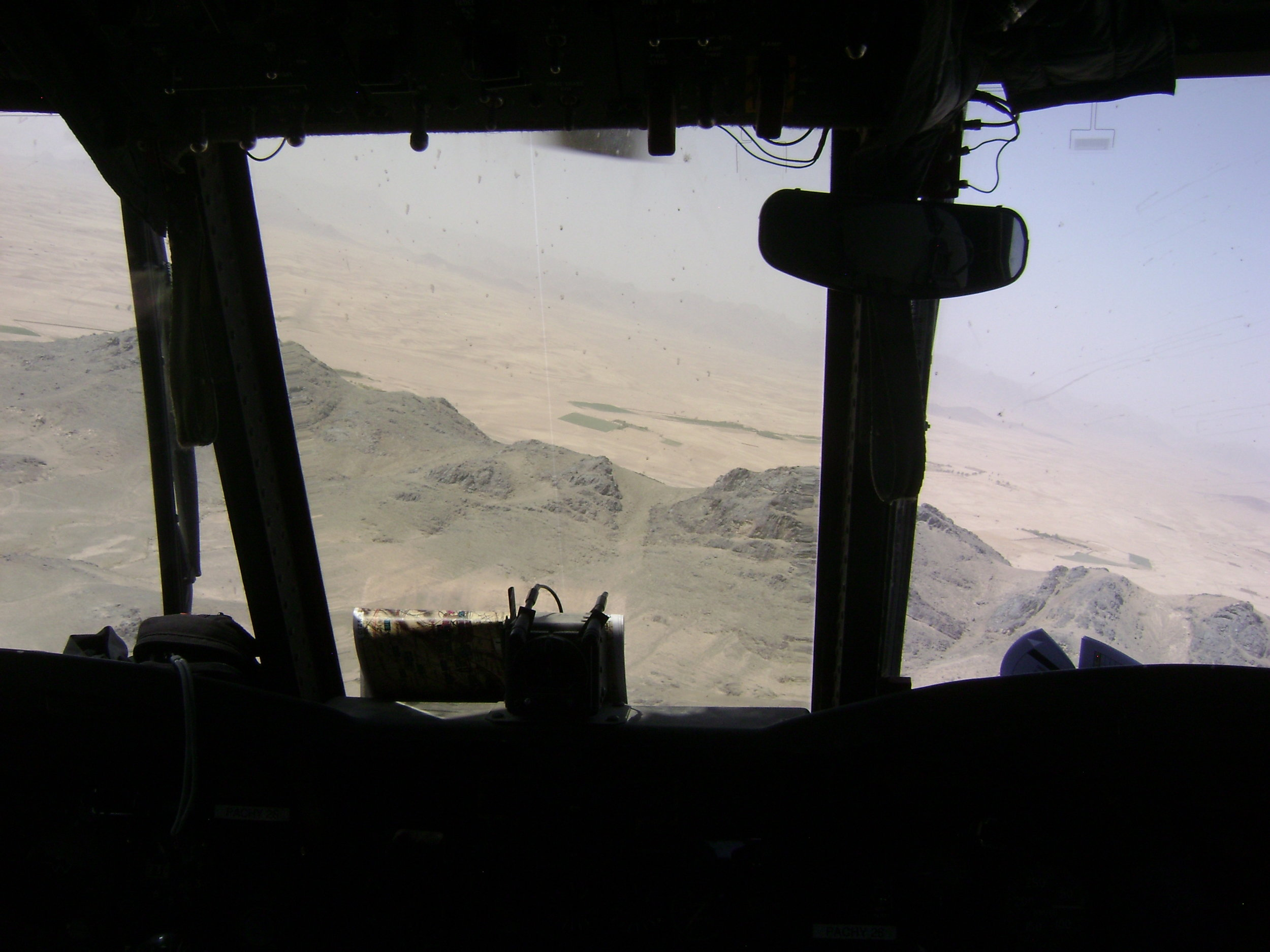Hills of Afghanistan, through helicopter windshield.