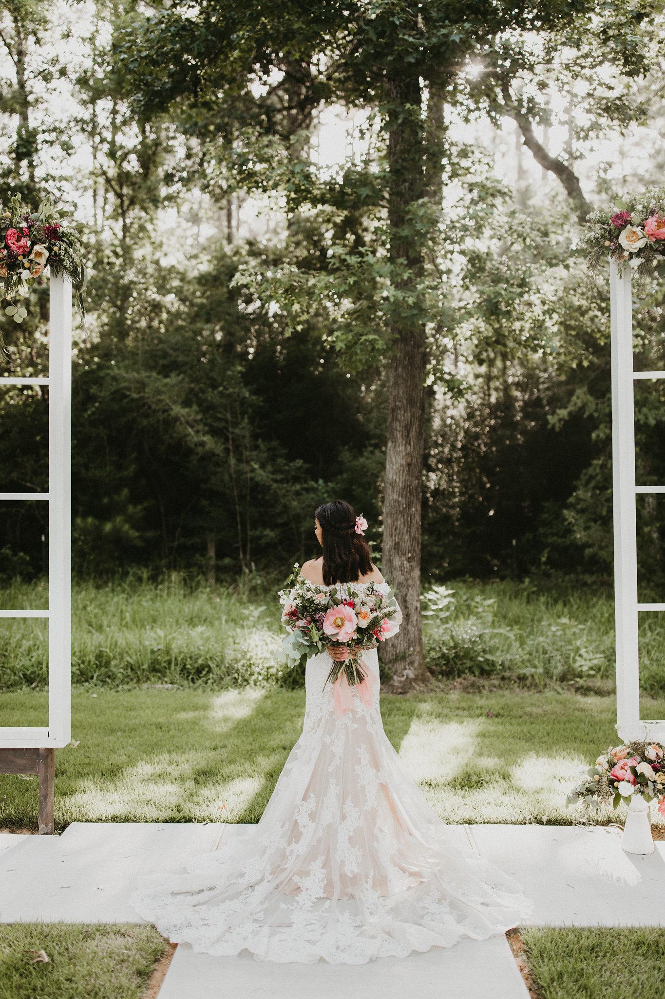 bridal inspiration bouquet behind back college station wedding coordinator epoch co