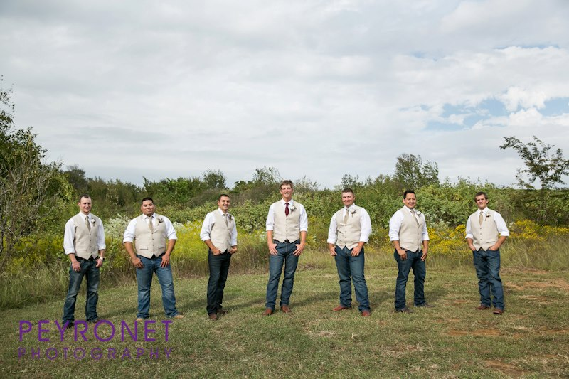 groomsmen in jeans with vest texas fall wedding double creek crossing peyronet photography