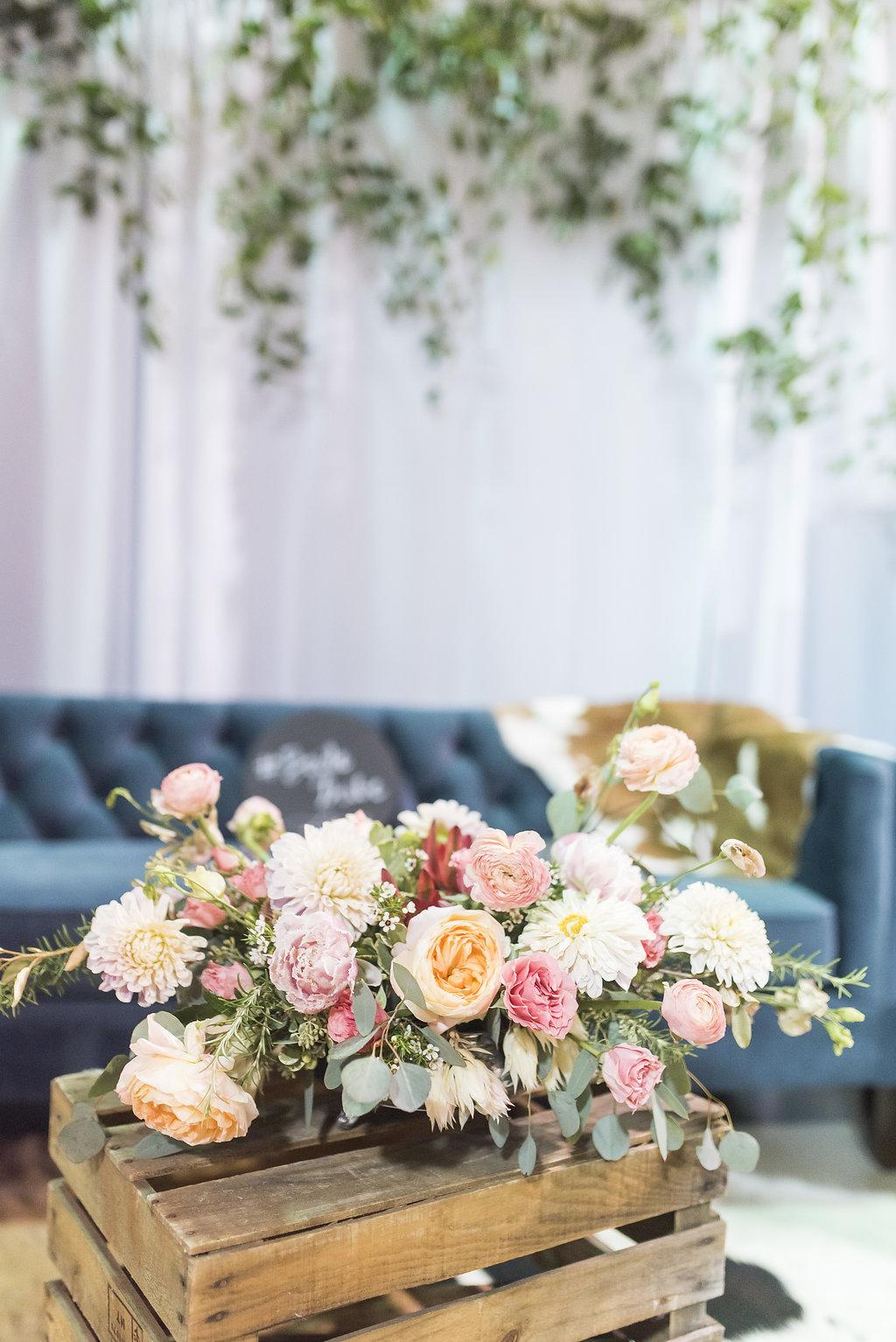 urban rubbish pink floral centerpiece college station texas wedding planner coordinator epoch co bridal booth
