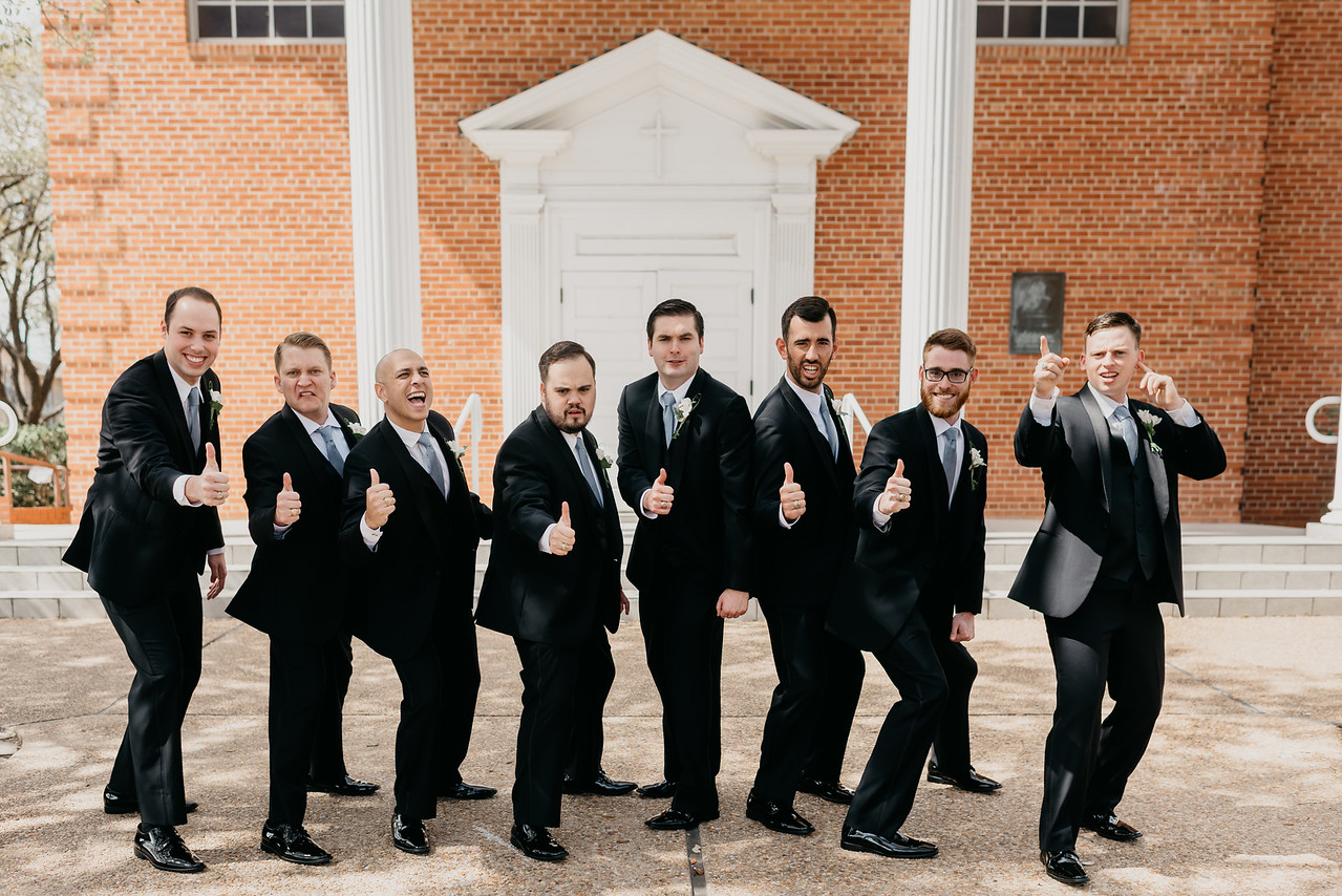 aggie wedding party groom groomsmen blue tie st marys catholic church college station wedding coordinator