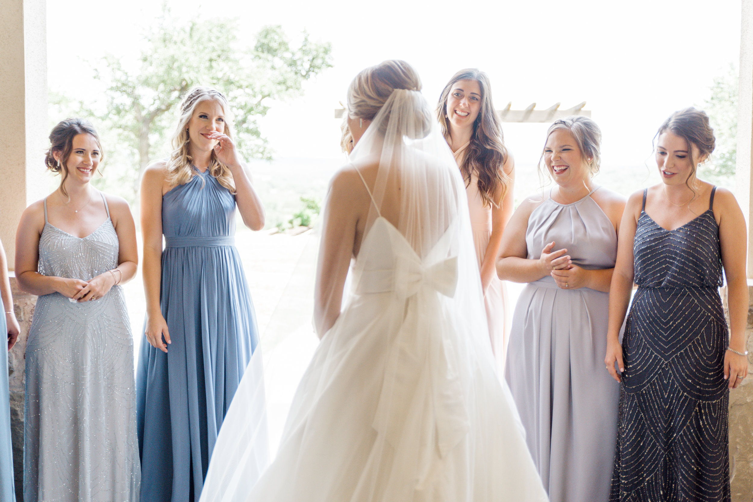 First look with bridesmaids wedding day austin wedding venue canyonwood ridge + destination planner coordinator epoch co + photographer erin elizabeth photo