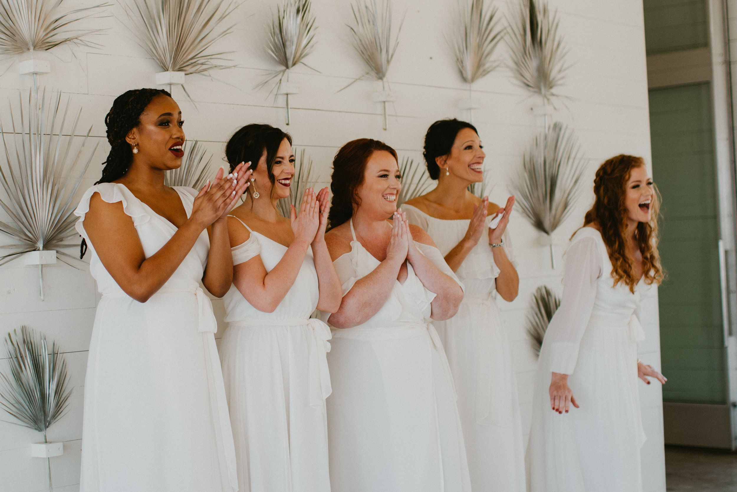 First look with bridesmaids wedding day austin mismatched white bridesmaid dress inspiration + destination planner coordinator epoch co + photographer century tree prospect house