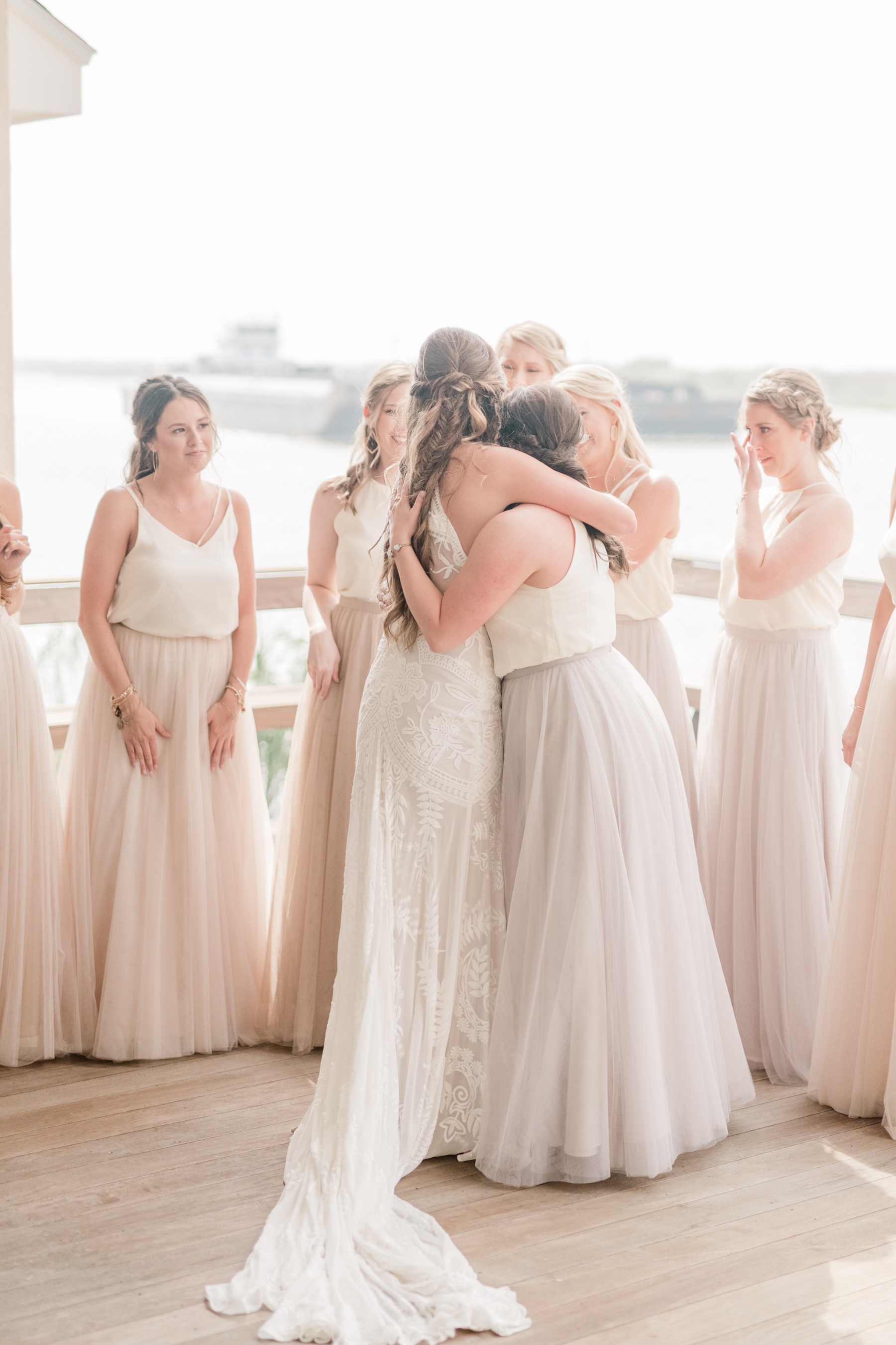 First look with bridesmaids wedding day beach galveston mismatched bridesmaid dress inspiration + destination planner coordinator epoch co + ten23 photography